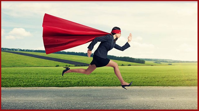concentrated superwoman in formal wear and red cloak with mask f